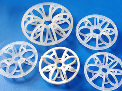 A white and four half transparent plastic rosette rings in different sizes on the blue background.