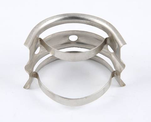 A metal nutter ring which on the white background shows the reverse side of it.