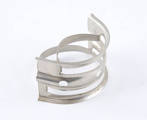 A metal nutter ring is placed diagonally on the white background.